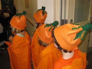 "Cinderella's pumpkin ""coach"" enters the show."